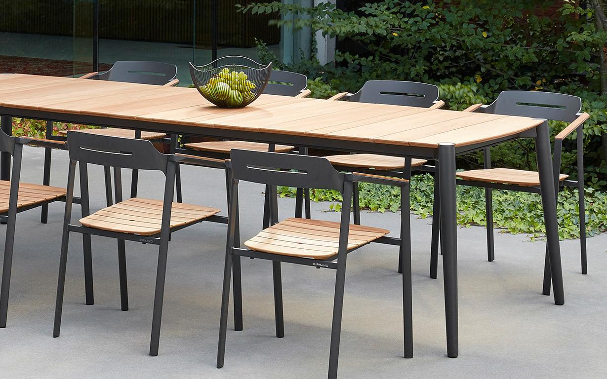 taula i cadires de teca i alumini